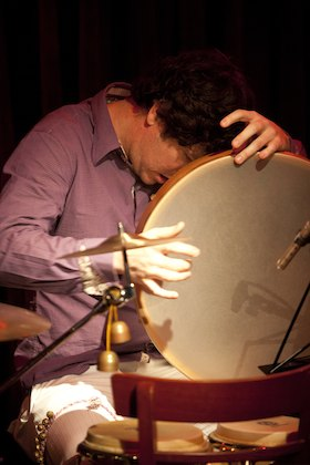 Mr. Ho plays lap-style bodhran on Phoenix Goodbye